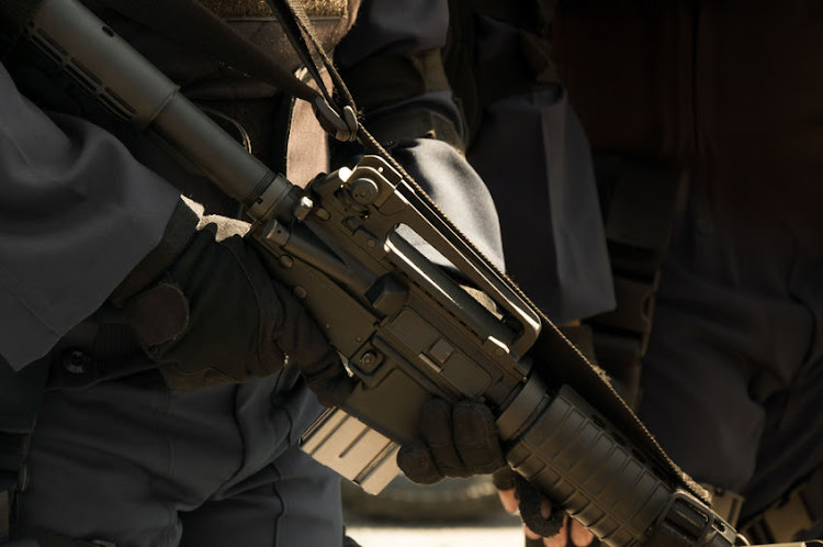 The robbers were armed with rifles and machine guns. File photo.