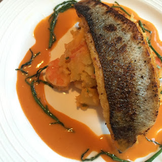 Pan Fried Sea Bass, Prawn Sauce, Crushed Potatoes And Samphire.