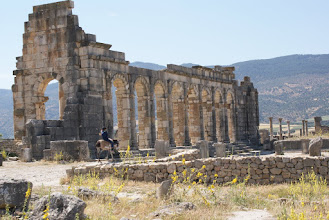 Photo: Donkey rider at ruins, Volubilis