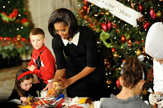 Photo: First Lady Michelle Obama welcomes children to begin decorating cookies, after welcoming military families who were the first to view the 2011 White House holiday season decorations. 37 Christmas trees decorate the White House, and the official White House tree stands 18 feet, 6 inches and is a balsam fir from the Schoeder's Forevergreens near Neshkoro, Wis. Photo by Jack Gruber, USA TODAY.