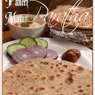 Paneer-Matar Paratha (Flat bread of whole wheat flour stuffed with spiced Indian cottage cheese and green peas).