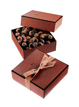 Photo: LA MAISON DU CHOCOLAT Truffle collection box featuring four flavors: pure dark chocolate, caramel toffee, orange and raspberry. 0.82 lbs. $95. France. Seventh Floor. 212 872 2686
