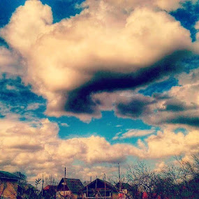 Clouds in village by Nat Bolfan-Stosic - Uncategorized All Uncategorized ( clouds, houses, nature, village, spring )