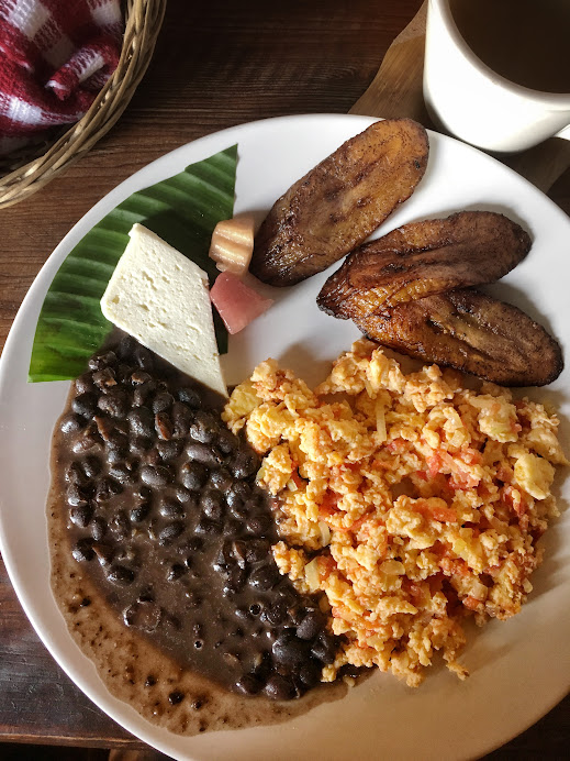 Typical Guatemalan breakfast: eggs, plaintain, beans, and cheese