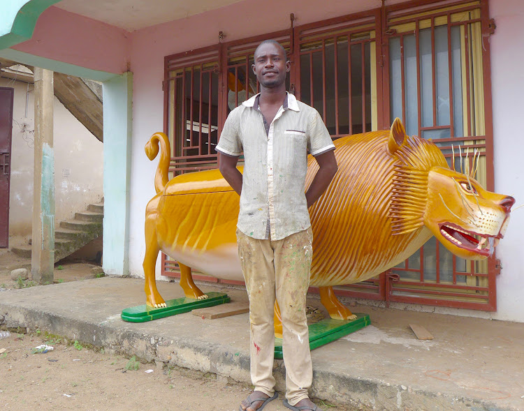 Jacob Tetteh-Ashong, son of Ghanaian coffinmaker Paa Joe, at their Teshie studio, Accra
