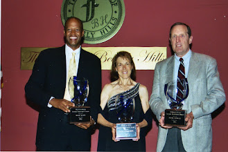 Photo: USATF-SCA Lifetime Achievement Awards Ceremony, 2004. Jacqueline with Willie Banks and Brian Springer.