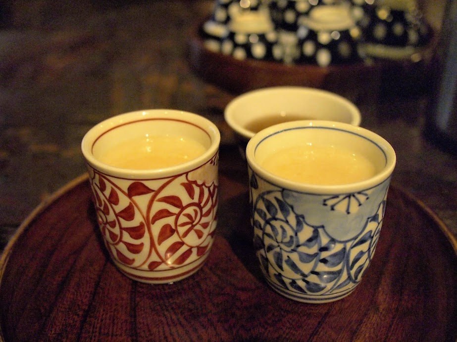Warm cups of amazake at Amazake-chaya teahouse. Amazake is is a traditional sweet, low- or non-alcohol Japanese drink made from fermented rice.