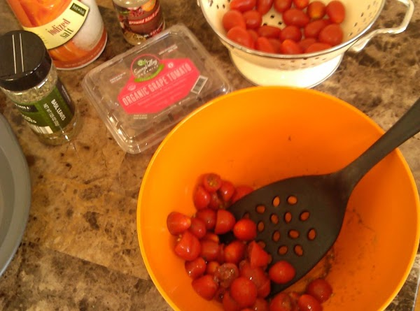 Cut tomatoes in half.  Add to mixing bowl.  Add salt, pepper and...