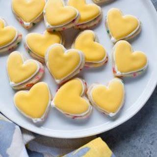 Yellow Heart-Shaped Rainbow Funfetti Cookies.