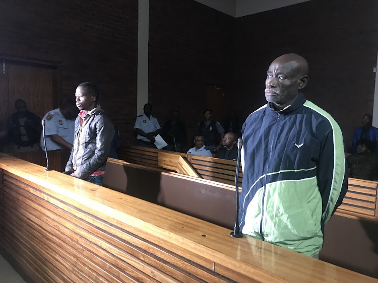Fita Khupe, right, and Ernest Mabaso appear in the Lenasia Magistrate's Court on seven counts of murder and theft after they allegedly killed members of the Khoza family in Vlakfontein last month.