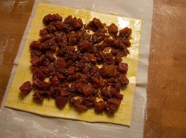 Spread the pizza sauce on top, leaving a 1/2-inch border all around.