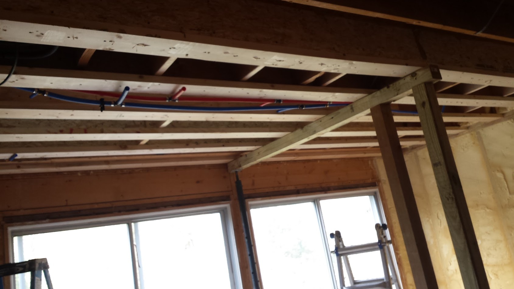 2x6s along the bottom of each joist and it's still jacked up