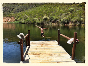 Photo: Jumping off the jetty into the dam