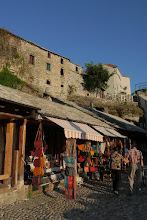 Photo: Cobbled street at Mostar old town lined with plenty of shops