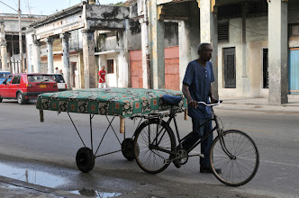 Photo: A man transports a mattress in Havana on September 24, 2010. Cuba is to allow some houses to be rented in US dollars for the first time in 50 years as well as the opening up of small businesses as it seeks to shed 500,000 public jobs, state media said Friday. AFP PHOTO/STR (Photo credit should read STR/AFP/Getty Images)
