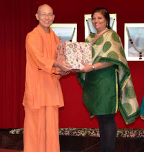 Photo: The Reading Mums coordinator, Mrs Suchitra receiving a token of appreciation in recognition of her efforts, from Swamiji.