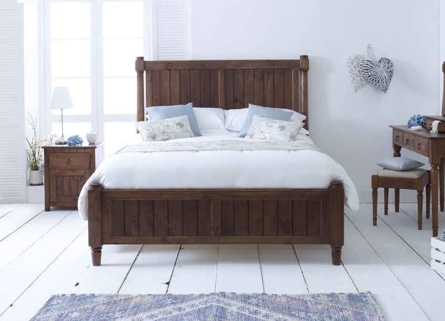 The 19th century-inspired Shaker Bed in situ with bedside cabinet and dressing table