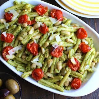 Kale Pesto Pasta with Roasted Tomatoes and White Beans.
