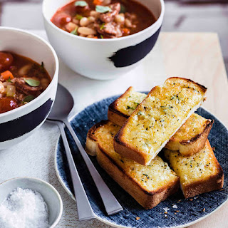 Bean, chorizo and tomato soup with Manchego soldiers