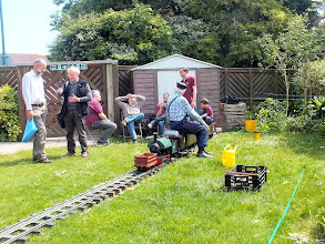 "Photo: 011 A very pleasant way to spend a sunny afternoon in West Sussex! The rear of the exhibition hall has a small garden, where a 5/7¼"" gauge line had been set up for the kiddies to have a ride, and the grown up kiddies to admire it whilst talking trains in general. Some well known modelling faces in view here ."