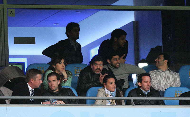 Photo: Diego Maradona (centre) watches from the stands