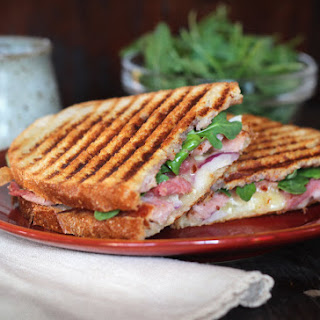 Ham and Camembert Cheese Panini with jam and arugula