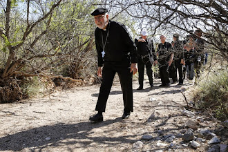 Photo: Bishop Gerald F. Kicanas of Tucson, Ariz., ducks under brush in the Arizona desert near Nogales March 31. He was in a group of U.S. bishops visiting the U.S.-Mexico border area to celebrate Mass, talk with migrants and recall the thousands who have died attempting to cross the Arizona desert. The bishops hiked an area where many migrants make their way after illegally crossing into the U.S. from Mexico. (CNS photo/Nancy Wiechec) (April 1, 2014)
