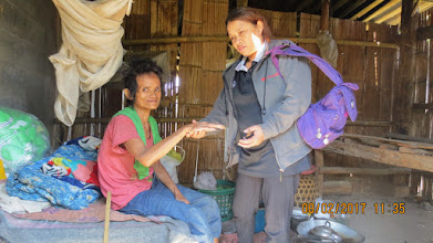 Photo: Baan Muang Khong:  Kanda with HIV patient