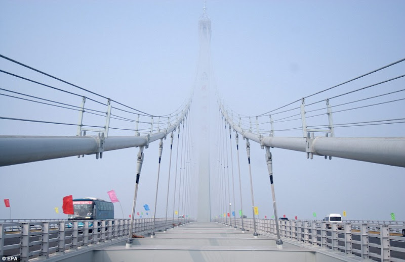 Photo: Record breaker : The Jiaozhou Bay Bridge,  spanning 26.4 miles between Qingdao and Huang  Dao, will open for traffic  today.