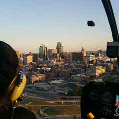 aerial view of helicopter training in Kansas City with passenger and skyline of downtown