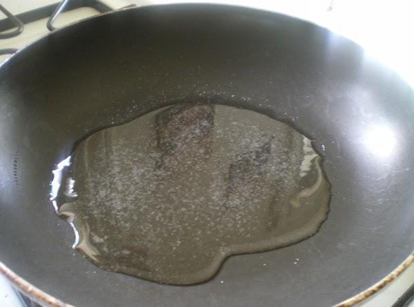In a medium skillet on medium heat add 2 tablespoons vegetable oil, and salt.