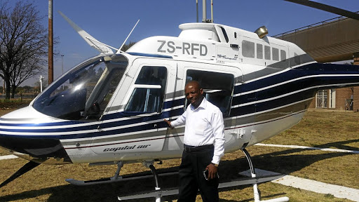 Soweto tourism entrepreneur Wiseman Ntombela flies visitors in choppers.