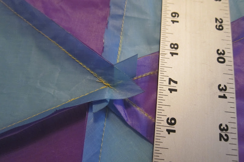 Photo: Now to reinforce the center joint - the light blue overlaps the purple (cut edge) and will get sewn down. Only 2 layers of fabric here.