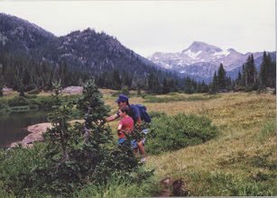 Photo: Me and dad in the vally before Eagle Cap peak in the Lostine mountains in eastern Oregon. I remeber this three or four day hike very well, except that in my memories I was way bigger and looked more grown up. My dad and I had snuck up near the bank of this creek to watch the fish; right then the bugs were out and so many little fish were biting the surface of the water that they looked like raindrops.