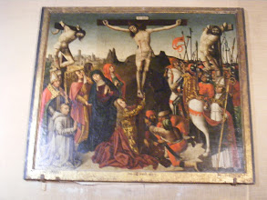 Photo: This crucifixion painting in a side chapel has quite an interesting history. It was commissioned in 1498 by the Chevalier de Thezan (who appears here as a kneeling Carthusian monk), on his marriage to Siffreine, the last descendant of a  prominent Venasque family. It is believed to have been a joint project by three artists (Flemish, German, and Italian) of the School of Avignon. It remained in the church for almost two centuries, but by the time of Louis XIV, it was judged unfashionable and placed in storage. It was rediscovered there in 1932, in poor condition, and so sent to the Louvre for restoration. It was then given a place of honor at a 1937 Louvre exhibition on Crucifixion art. Afterwards, the Louvre refused to return it, despite protests from many in the French art world. It was finally returned in 1937, following a petition by 700 art notables.