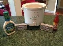 Combine cream cheese, hot sauce and ranch dressing in crock pot.  (Yes, entire...
