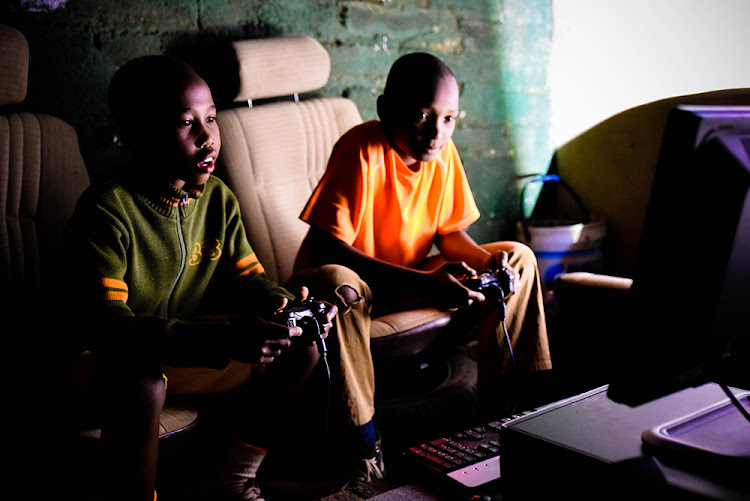 Two boys play games at Trackside Creative in Soweto. The 2016 A MAZE festival had a pop-up in the township for one night last year.