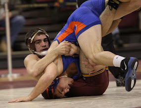 Photo: 157 – #20 George Ivanov, Boise State, dec. Brad Dolezal, Minnesota, 10-3. Photo by Mark Beshey.