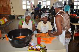 Photo: Village women hired to cut veggies