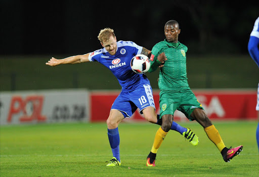 Michael Morton of Supersport United challenged by Nduduzo Sibiya of Golden Arrows during the Absa Premiership 2016/17 match between Golden Arrows and Supersport United at Princess Magogo Stadium, KwaMashu South Africa on 28 September 2016 ©Muzi Ntombela/BackpagePix