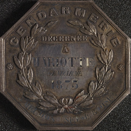 Octagonal silver medal, awarded to gendarme, Mario