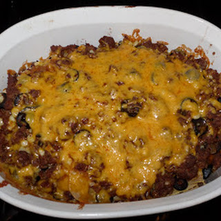 Layered Beef Mexicali Casserole using Corn Tortillas.