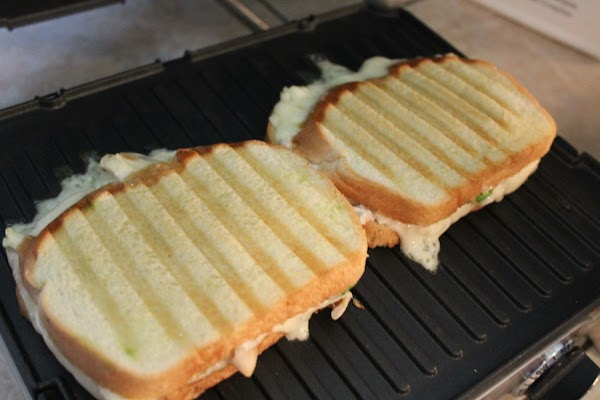 Place the sandwiches in your panini grill for approx. 5 minutes, maybe less. Watch...