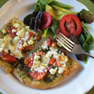 Pesto Pizza with Feta and Tomatoes.