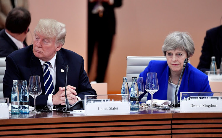 US President Donald Trump and Britain's Prime Minister Theresa May wait at the start of the first working session of the G20 meeting in Hamburg, Germany, on July 7, 2017.    File photo: REUTERS/JOHN MACDOUGALL