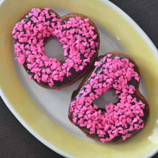 Chocolate Frosted Heart-Shaped Doughnuts.