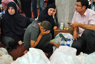 Photo: Family members of those killed in Wednesday morning's police and military crackdown on two pro Morsi sit ins arrive at the Iman Mosque in Nasr City to identify the bodies. The brutal raid killed over 600 people and left several thousands more injured. Cairo, EGYPT - 15/8/2013. Credit: Ali Mustafa/SIPA Press