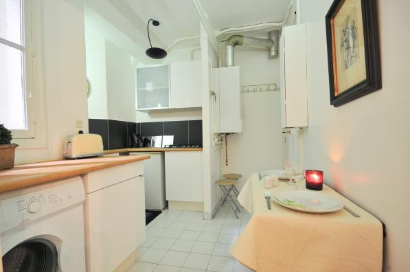 Fully equipped kitchen at 2 Bedroom Apartment in Louvre & Les Halles