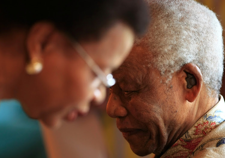 FILE PHOTO: The late president Nelson Mandela and his wife Graca Machel.