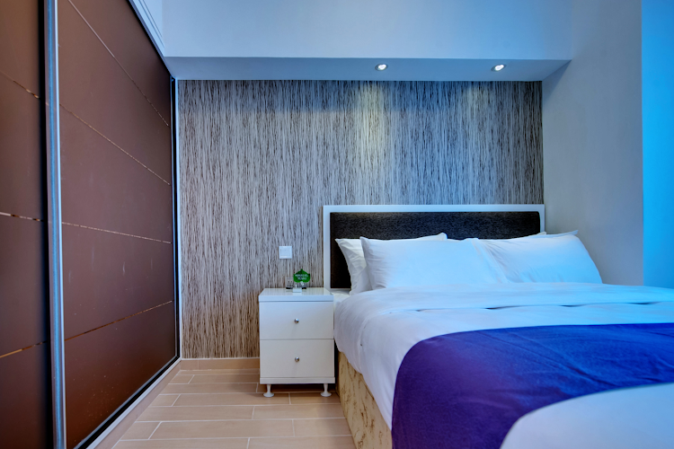 Bed at Charasmatic & Central Apartments in Sheung Wan, Hong Kong